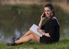 Business woman with an agenda. In the park Stock Photo