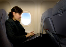 Business woman in airplane Stock Photography