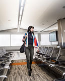Business woman in airport Stock Photo