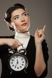 The business woman with an alarm clock Royalty Free Stock Photo