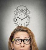 Business woman with alarm clock above her head Royalty Free Stock Photography