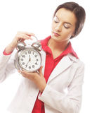 The business woman with an alarm clock Stock Photography