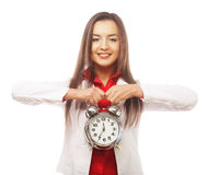 The business woman with an alarm clock Royalty Free Stock Photography