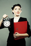 The business woman with an alarm clock Stock Photos