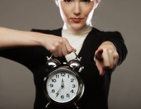 The business woman with an alarm clock Stock Images