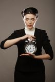 The business woman with an alarm clock Stock Image