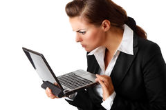 Business woman amazedly looks in laptops screen. Modern business woman amazedly looks in laptops screen isolated on white Royalty Free Stock Images