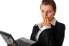 Business woman amazedly looks in laptops screen Royalty Free Stock Photo