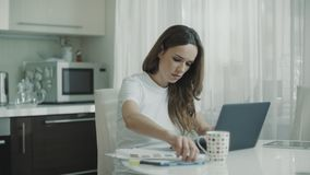 Business woman analysing financial data charts at home workplace stock video