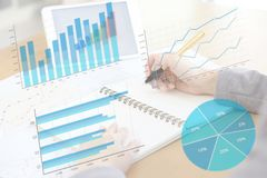 Business woman analysis with financial graph at office,. Workplace stock images