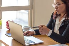 Business woman analyzes the graph on the computer. stock photo