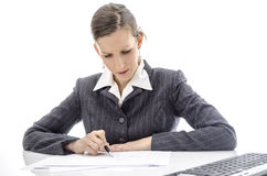 Business woman analyzing documents Royalty Free Stock Image