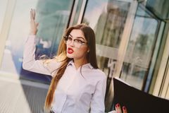 Angry boss screaming at the staff. Business woman angry boss screaming at the staff royalty free stock image