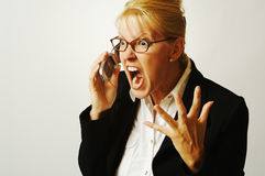 Business Woman Angry on the Ce. Business woman expresses her anger while on her cell phone Stock Photo