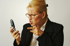 Business Woman Angry on the Ce. Business woman expresses her anger while on her cell phone Royalty Free Stock Photo