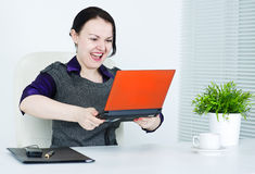 Business woman angry on computer Stock Photos