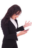 Business woman angry at phone Royalty Free Stock Photos