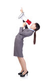 Business woman angry shouting with a megaphone. Business woman screaming with a megaphone and finger point to up forward copy space in full length isolated on Stock Images