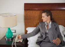 Business woman answering phone call in hotel room Royalty Free Stock Photos