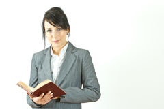 Business woman with appointment book. Young business woman with appointment book royalty free stock photo