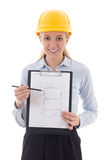 Business woman architect in builder helmet holding clipboard wit Royalty Free Stock Photography