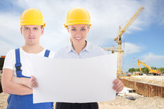 Business woman architect and man builder in yellow helmet Stock Images