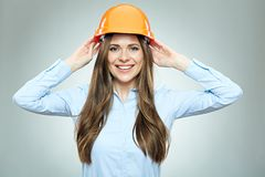 Business woman architect touching safety helmet. Royalty Free Stock Image