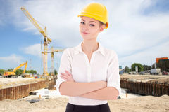 Business woman architect in yellow builder helmet Stock Photo