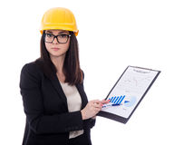 Business woman architect in yellow helmet holding clipboard with Stock Image