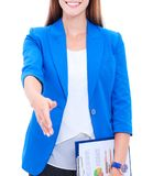 Business woman with arm extended for a handshake.  Stock Images