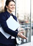 Business woman with arm extended Stock Photos