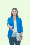 Business woman with arm extended for a handshake.  Royalty Free Stock Image
