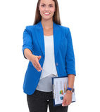 Business woman with arm extended for a handshake Royalty Free Stock Photography