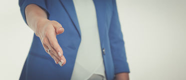 Business woman with arm extended for a handshake.  Stock Image