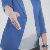 Business woman with arm extended for a handshake.  Royalty Free Stock Photos