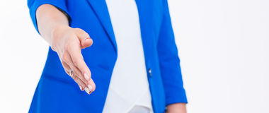 Business woman with arm extended for a handshake.  Royalty Free Stock Photography
