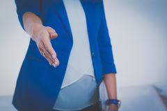 Business woman with arm extended for a handshake.  Stock Photo