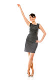 Business woman with arm stretched Stock Photos