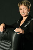 The business woman and armchair Royalty Free Stock Photo