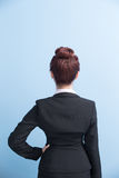 Business woman arms akimbo. And back to you with isolated on blue background, asian Stock Photos