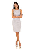 Business woman arms crossed. Confident indian business woman with arms crossed on white background Royalty Free Stock Photo