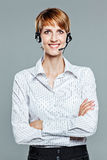 Business woman with arms crossed and headset Royalty Free Stock Images