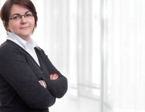 Business woman arms folded Stock Photos