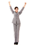 Business woman with arms up Stock Photo