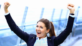 Business woman with arms up celebrating outdoor. Successful business woman with arms up celebrating outdoor royalty free stock images