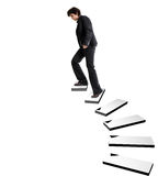 Business woman ascending stairs. On white background Stock Image