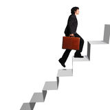 Business woman ascending stairs. Business woman with briefcase ascending stairs against white background Stock Image