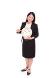 Business woman (asian) with a clock Royalty Free Stock Photography