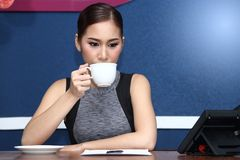 Business Woman Asian have Coffee before work in morning Stock Image