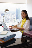 Business Woman Assistant Smiles At Camera Typing On PC Stock Image